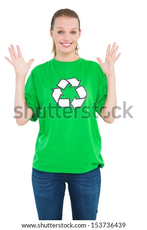 Surprised pretty environmental activist raising her hands on white background - stock photo