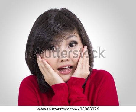 surprised pretty young girl - stock photo