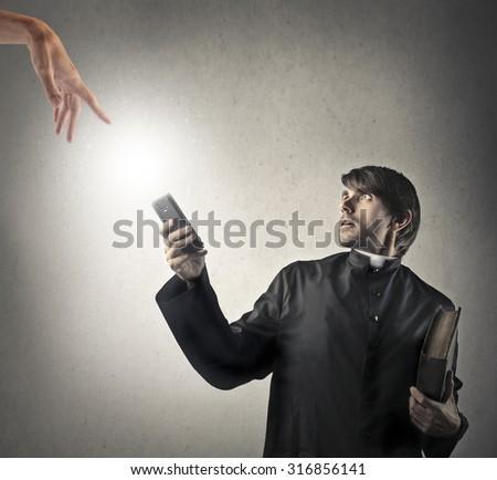 Surprised priest - stock photo