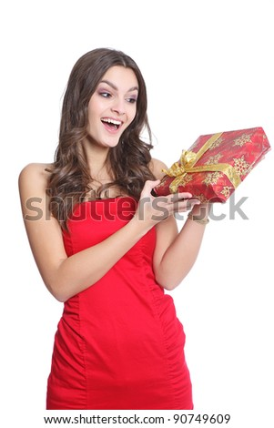 Surprised red dressed girl with a present - stock photo