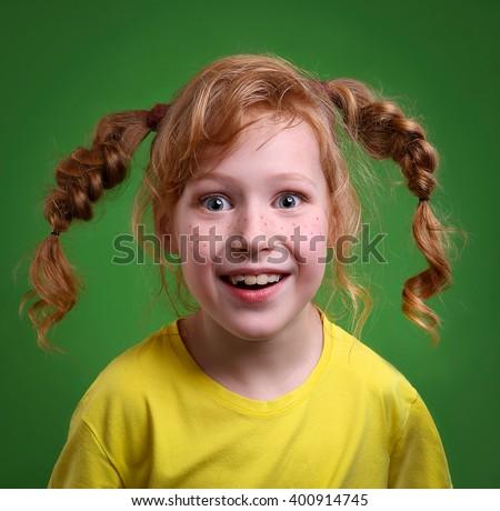 Surprised redhead girl with pigtails.
