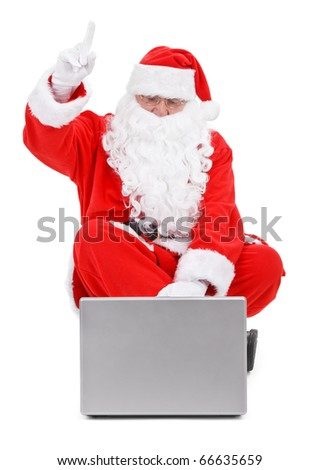 Surprised Santa claus and laptop on white background - stock photo