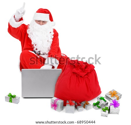 Surprised Santa Claus with laptop and presents  on white background - stock photo