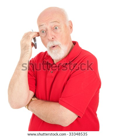 Surprised senior man talking on his cell phone.  Isolated on white.