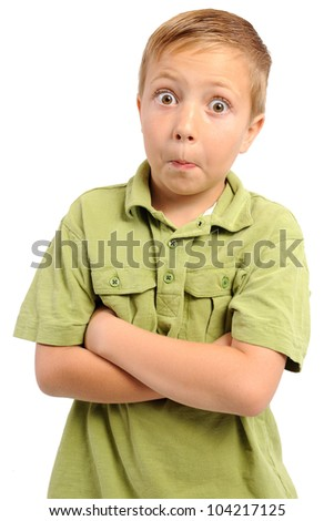 Surprised Seven Year Old. Boy with eyes wide open as if he is reacting to something surprising. Isolated on white. - stock photo
