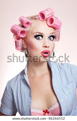 Surprised sexy housewife - stock photo