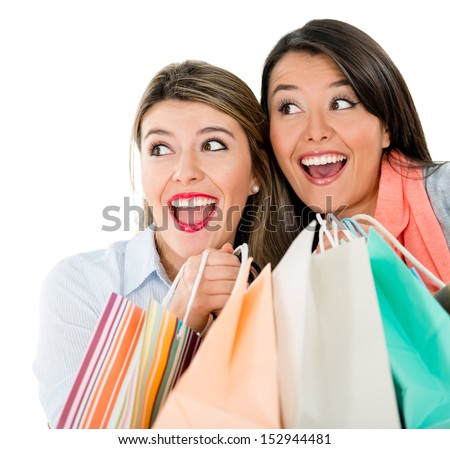 Surprised shopping women holding bags - isolated over a white background  - stock photo