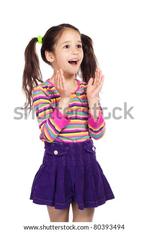 Surprised smiling little girl, isolated on white
