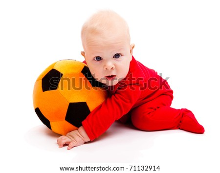 Surprised soccer baby with his mouth  open - stock photo