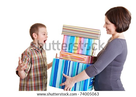 Surprised son receiving many gifts from his mother - stock photo