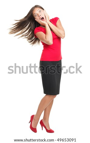 Surprised standing woman on white. Funny full length portrait of cheerful surprised and excited beautiful mixed Chinese Asian / Caucasian young woman model isolated on white background. - stock photo