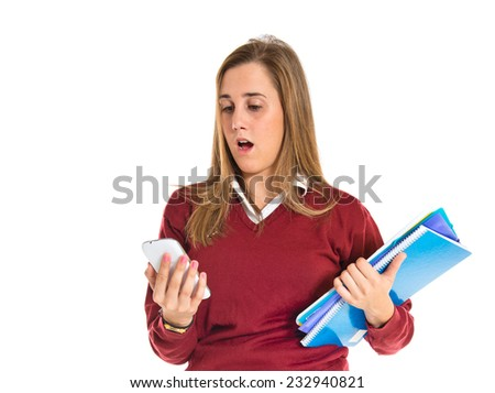 Surprised student talking to mobile over white background  - stock photo
