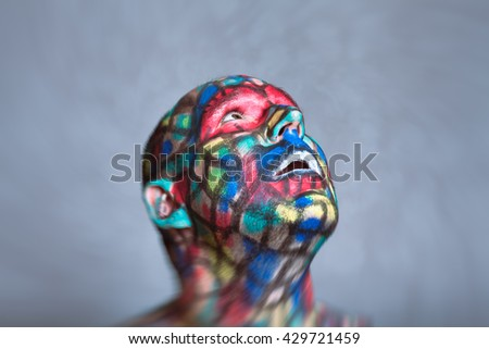 Surprised Superhero portrait, colorful face art with tilt shift and motion blur effect. - stock photo