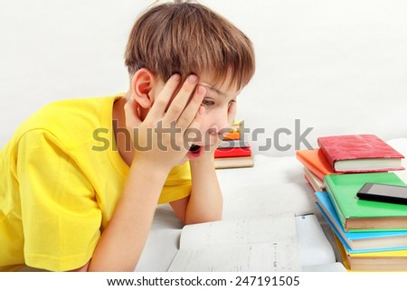 Surprised Teenager doing Homework at the Home - stock photo