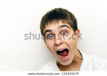Surprised Teenager portrait with opened mouth on the White background - stock photo