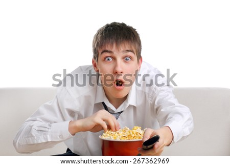 Surprised Teenager with Remote Control and Popcorn on the White Background - stock photo
