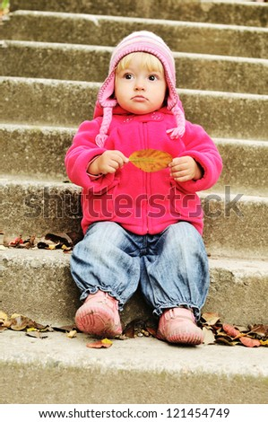 surprised toddler on the stairs - stock photo