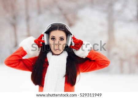 Surprised Winter Woman With Wireless Headphones - Excited girl listening to music outside