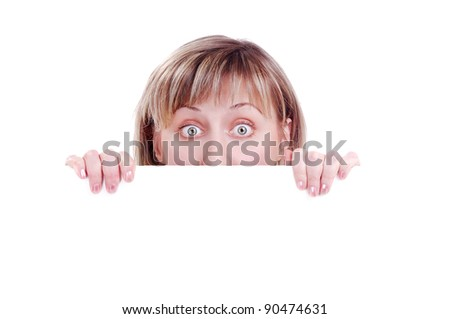 Surprised woman behind the blank board - half of face, big eyes - stock photo