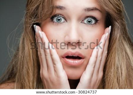 surprised woman closeup, studio shot - stock photo