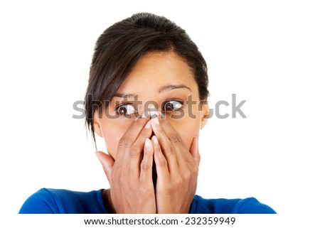 Surprised woman covering with hands her mouth.