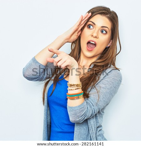 Surprised woman finger pointing on copy space. Price down advertising concept. Amazement emotion. - stock photo