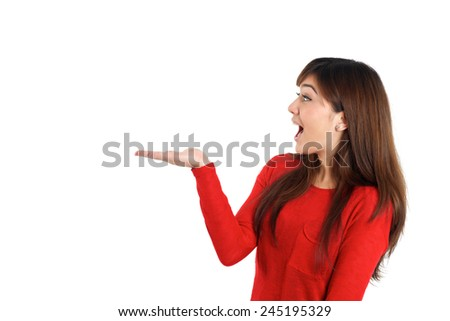 Surprised woman holding empty placeholder product on white background
