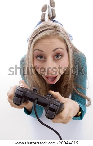surprised woman holding remote control against white background - stock photo