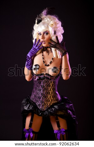 Surprised woman in burlesque outfit, studio shot
