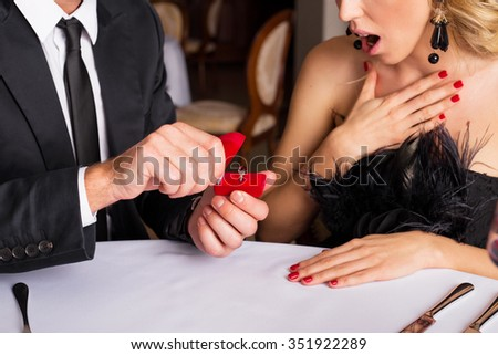 Surprised woman looking at engagement ring  - stock photo