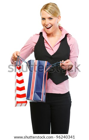 Surprised woman looking in shopping bag - stock photo