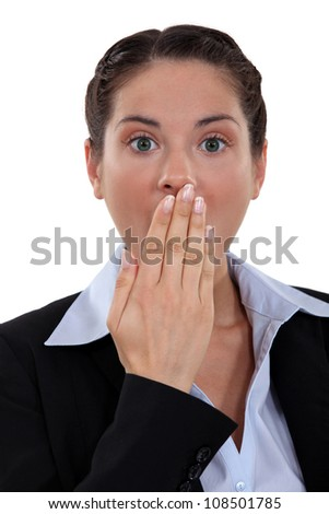 surprised woman putting hand on her mouth