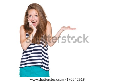 Surprised woman showing open hand palm with copy space for product or text - stock photo