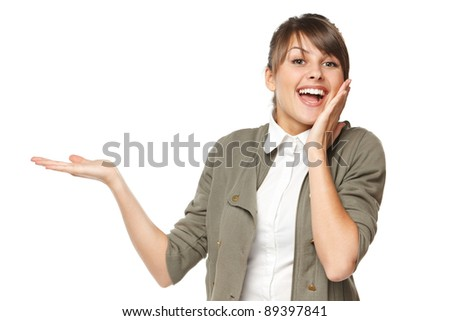Surprised woman showing open hand palm with copy space for product or text, isolated on white background