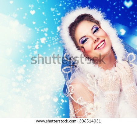 surprised woman wearing a fur-coat, isolated against blue background, winter topic - stock photo