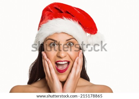 Surprised woman wearing santa hat on white background