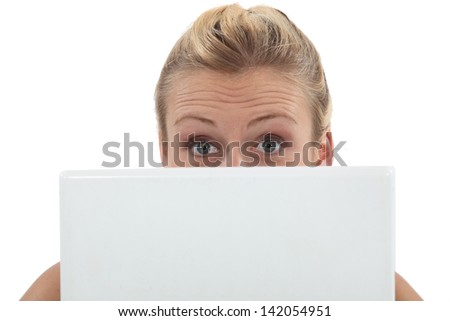 Surprised woman with a laptop - stock photo