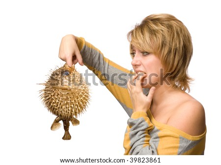 Surprised woman with fish isolated over white background - stock photo