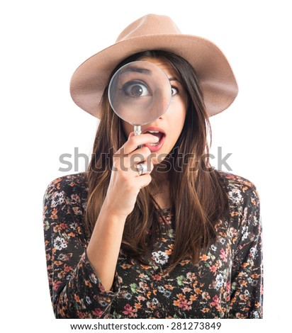 Surprised woman with magnifying glass  - stock photo