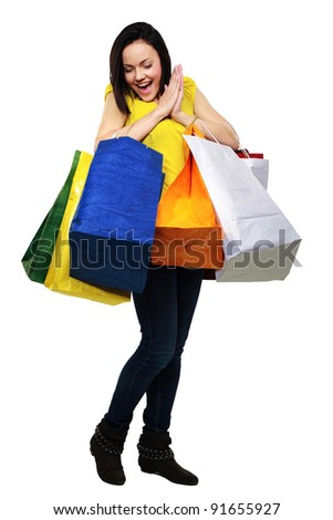Surprised woman with shopping bags isolated on a white background - stock photo