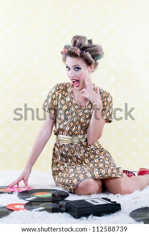 Surprised woman with vinyl record on carpet. - stock photo