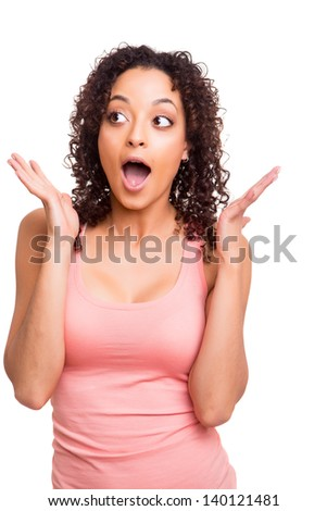 surprised young african woman over white background - stock photo