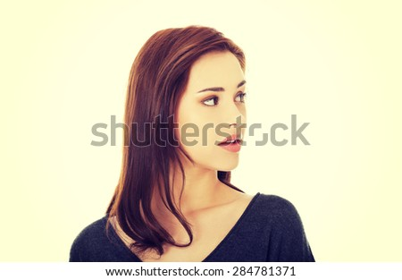 Surprised young beautiful brunette woman
