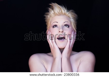 Surprised young blond woman portrait.