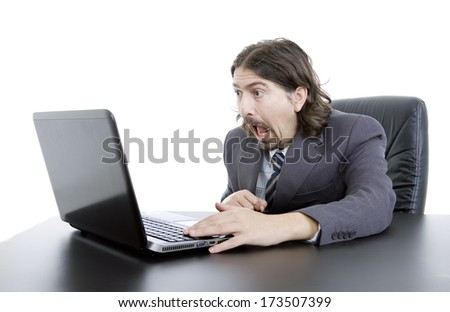 surprised young businessman working with is laptop