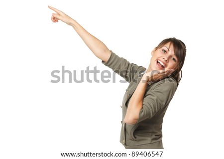 Surprised young female pointing at copy space, over white background - stock photo