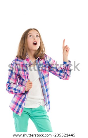 Surprised young girl in lumberjack shirt pointing and looking up. Three quarter length studio shot isolated on white. - stock photo