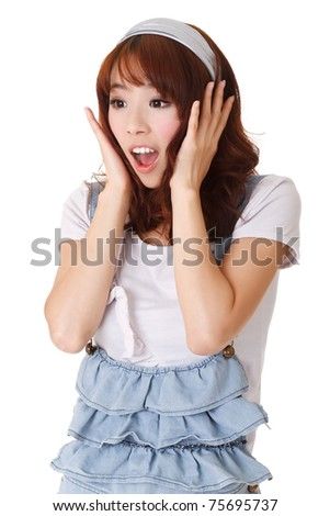 Surprised young girl of Asian, half length closeup portrait on white background. - stock photo