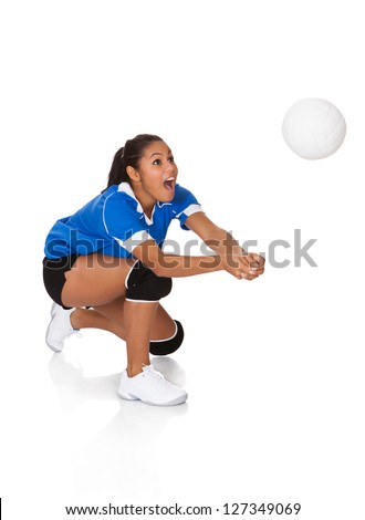 Surprised Young Girl Playing The Volleyball. Isolated On White - stock photo