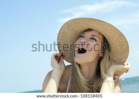 surprised young girl wearing a hat - stock photo